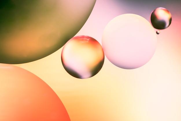 Roze en oranje abstracte achtergrond met bubbels