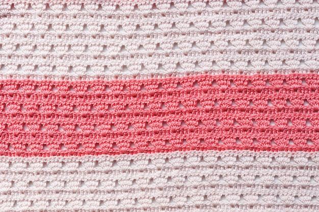 Roze en wit gebreid breipatroon, stipes.