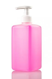 Roze fles vloeibare zeep of gel met een pomp op een wit geïsoleerd close-up als achtergrond.