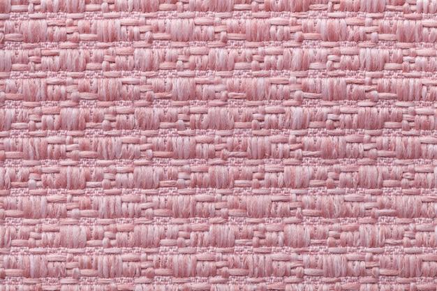 Roze gebreide wollen achtergrond met een patroon van zacht