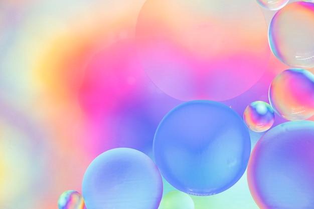 Roze gele en blauwe abstracte achtergrond met bubbels
