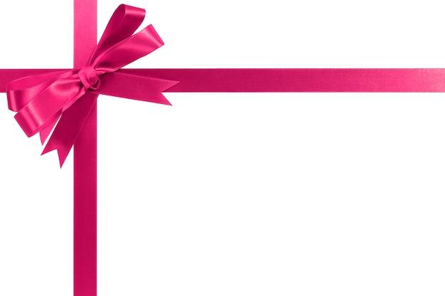 Roze geschenk lint boog horizontale hoek dwarsvorm geïsoleerd op wit.