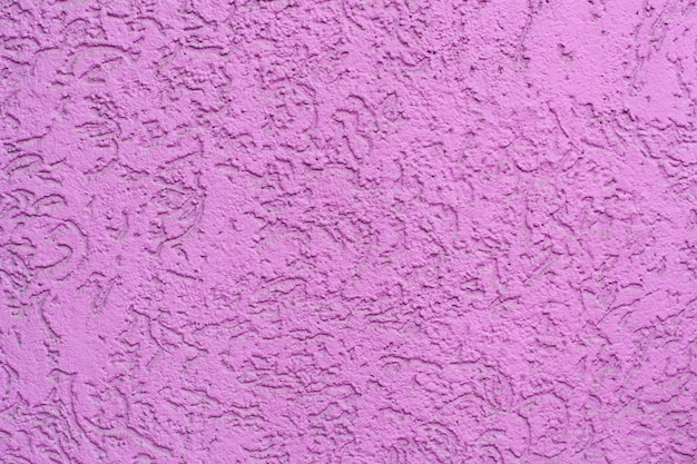 Roze gipspleister geweven muur
