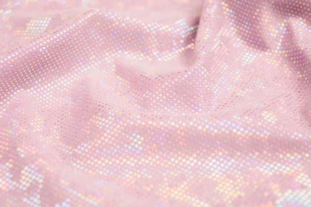 Roze glanzende stof gestructureerde achtergrond.