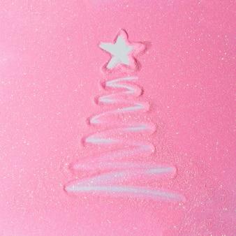Roze glitter achtergrond met kerstboom. plat lag glanzende textuur. nieuwjaar concept.