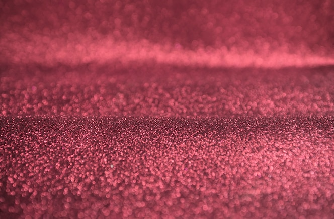 Roze glitter gouden bokeh lichten achtergrond