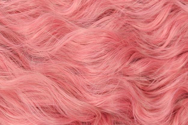 Roze golvend haarpatroon. bovenaanzicht.