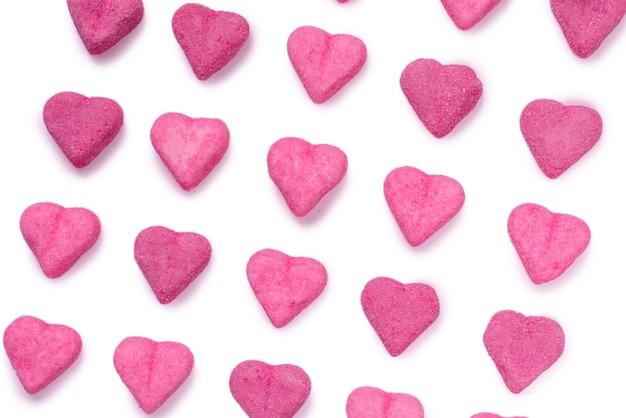 Roze gummy snoepjes. bovenaanzicht. gelei snoep. geïsoleerd op een witte achtergrond.