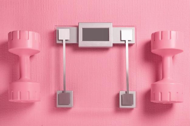 Roze halters en weegschaal op de fitnessmat