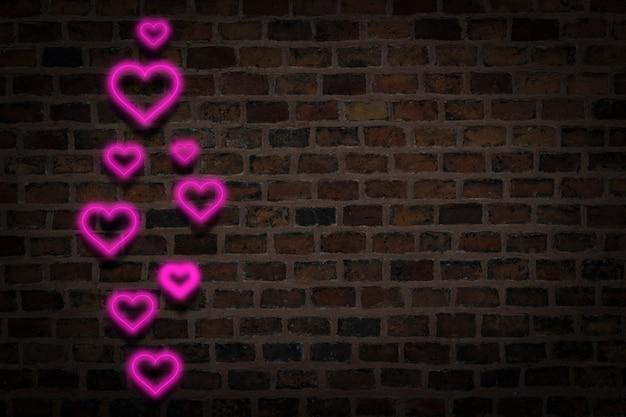 Roze harten, neonteken op de achtergrond van de brandmuur. valentijnsdag concept, liefde.