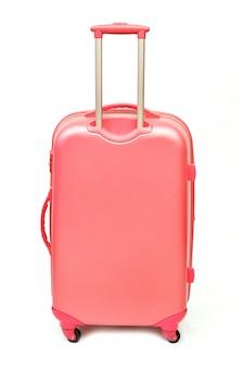 Roze koffer die op wit wordt geïsoleerd