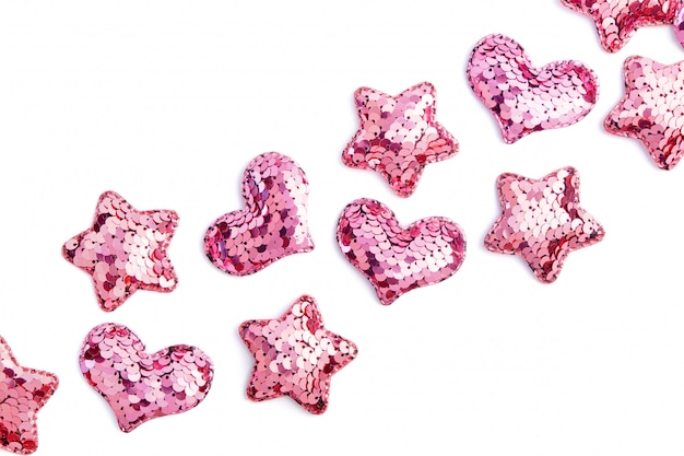 Roze lovertjeharten en sterren op wit