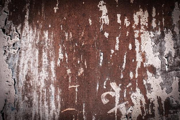 Roze, paars, lila, textuur. oude roestige muur achtergronden. ruwheid en scheuren. kader, vignet