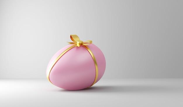 Roze paasei met gouden lint en boog op wit