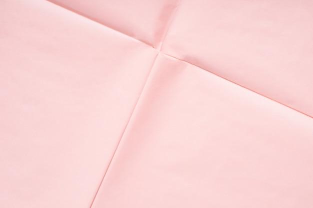 Roze papieren achtergrond met vouw textuur