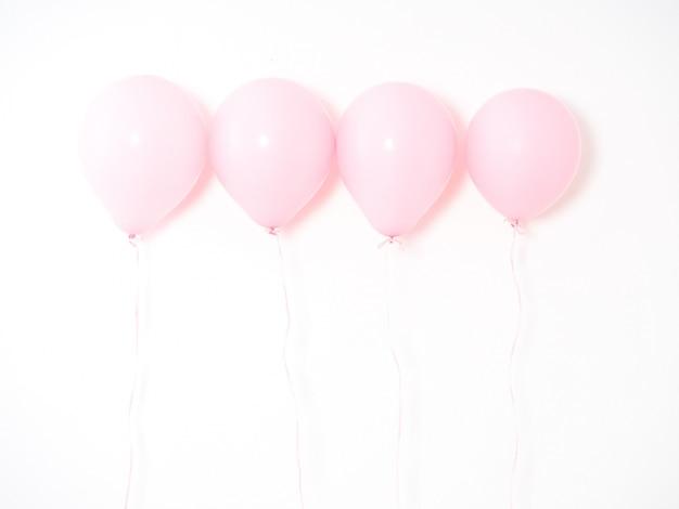 Roze pastelkleur van de ballon op grijs