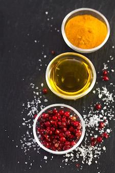 Roze peper met olijfolie