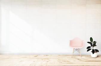 Roze stoel in een witte ruimte