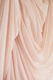 Roze stoffentextuur voor abstracte achtergrond, ontwerp en behang, zachte en onduidelijk beeldstijl