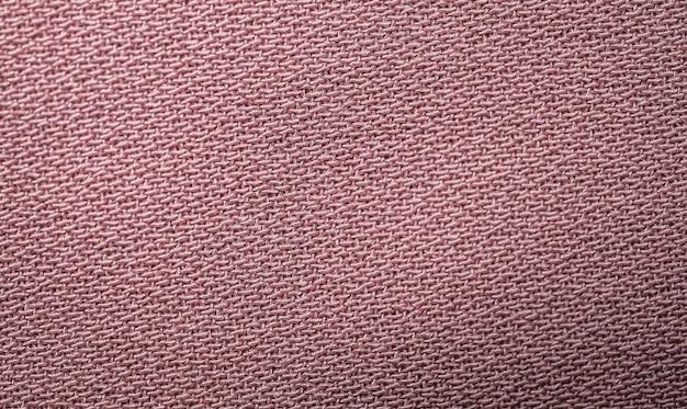 Roze textiel abstracte achtergrond. detailopname