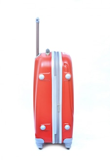 Roze van moderne grote koffer op een wit