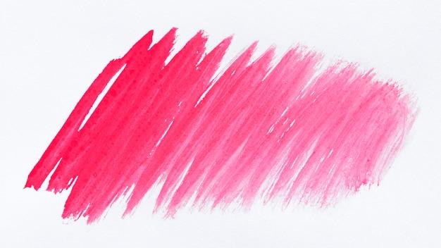 Roze verf op een witte achtergrond
