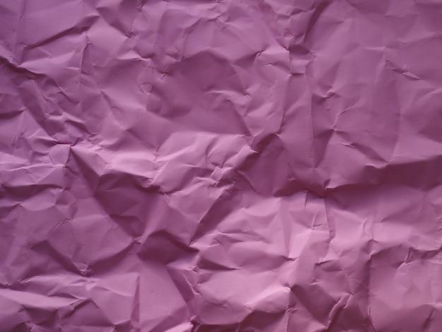 Roze verfrommelde gerimpelde geweven document achtergrond.