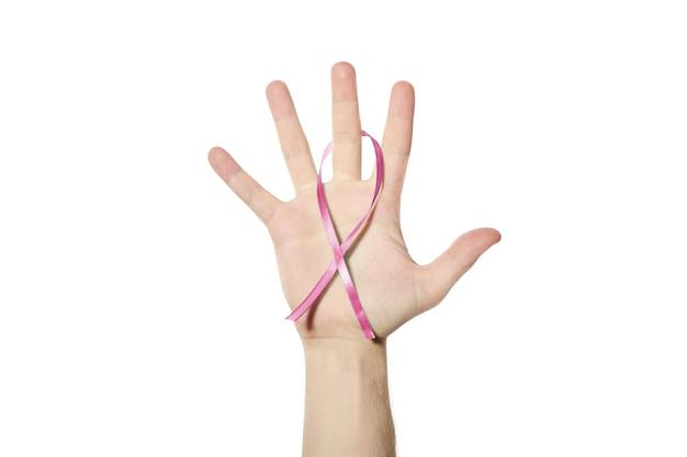 Roze voorlichtingslint ter beschikking. symbool van borstkanker. symboliek van de national breast cancer awareness month. witte geïsoleerde achtergrond.