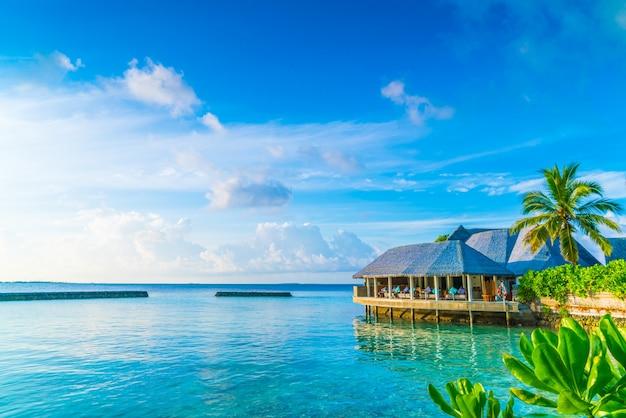 Rust zonneschijn atol bungalow vakantie