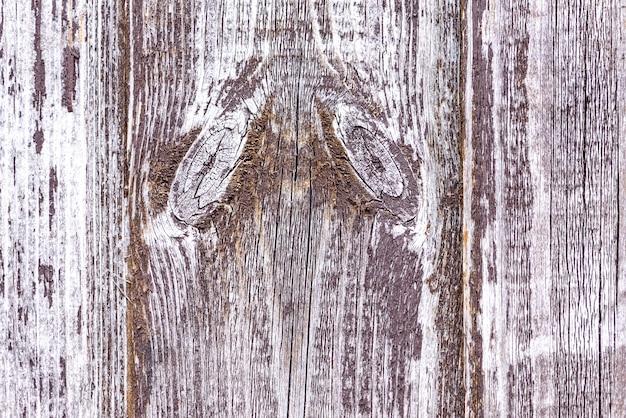 Rustieke bruine de schors houten geweven abstracte achtergrond van de plankomheining.