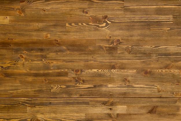 Rustieke doorstane bruine houten achtergrond