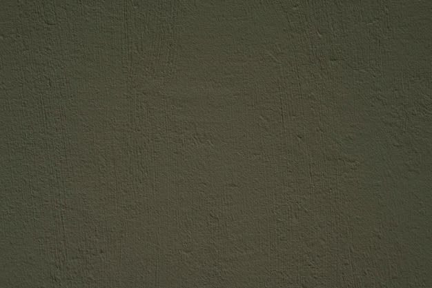 Rustieke getextureerde donkergroene cementmuur. concrete achtergrond.