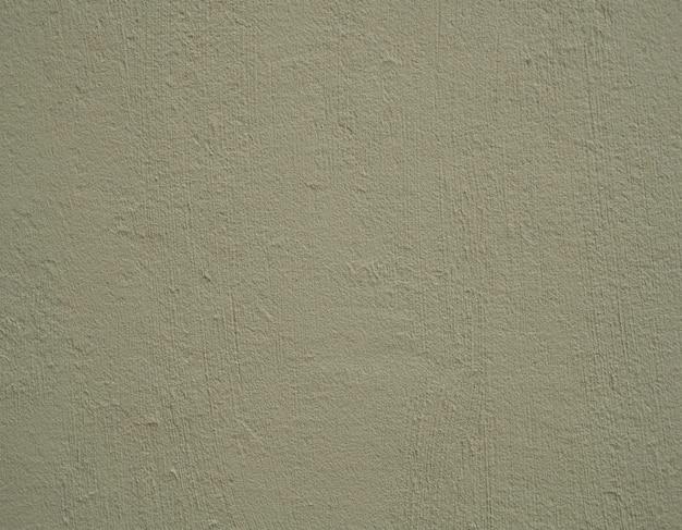 Rustieke getextureerde lichtgroene cementmuur. concrete achtergrond.