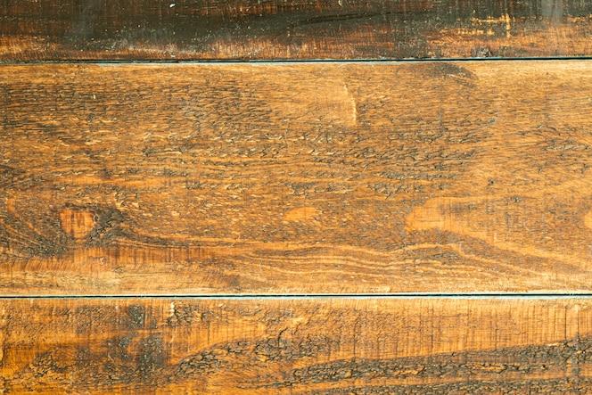 Rustieke houten planken geschilderd in donkerbruin
