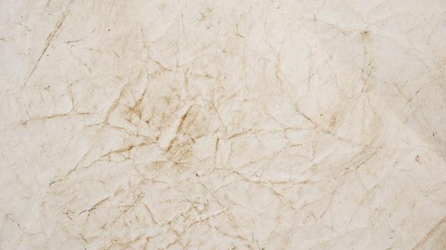 Ruwe beige document grunge textuur als achtergrond voor ontwerp