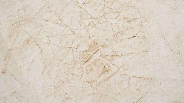Ruwe beige document grunge textuur als achtergrond