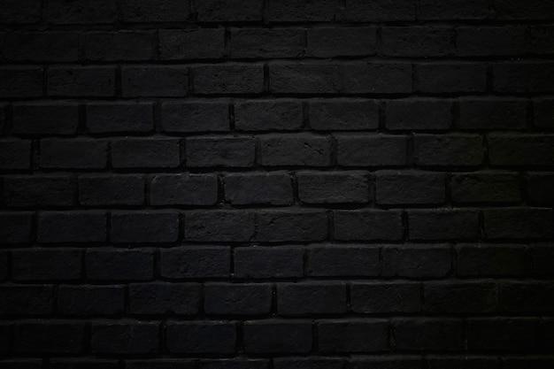 Ruwe de baksteen van de bakstenen muurtextuur donkere zwarte als achtergrond