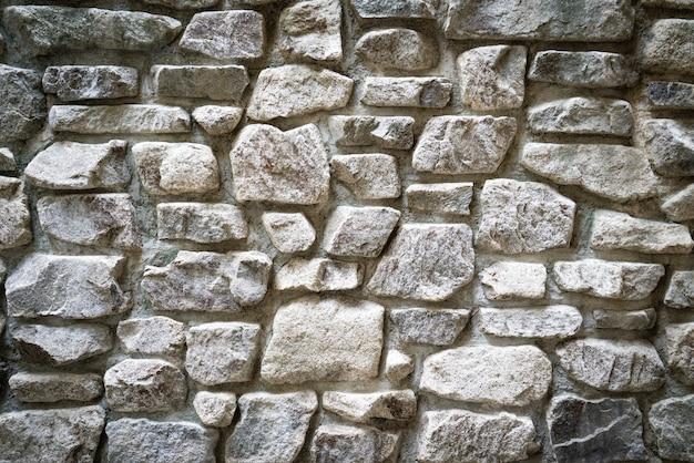 Ruwe de textuurachtergrond van de muurrots