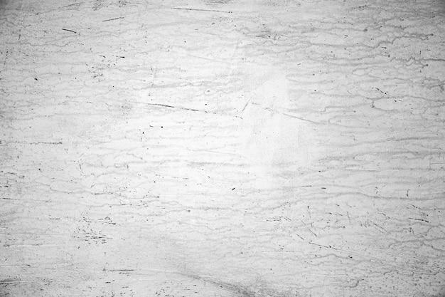 Ruwe getextureerde muur met krassen en scheuren