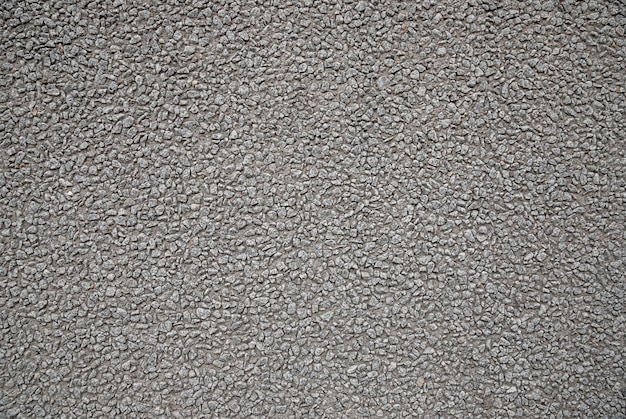 Ruwe grijze concrete de textuurachtergrond van de steenmuur, stad die buitendecor bouwen