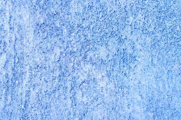 Ruwe textuur van abstracte decoratieve lichtblauwe achtergrond van pleistermuur. Premium Foto
