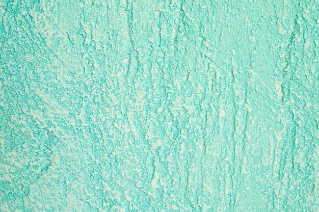 Ruwe textuur van abstracte decoratieve lichtgroene achtergrond van pleistermuur. Premium Foto