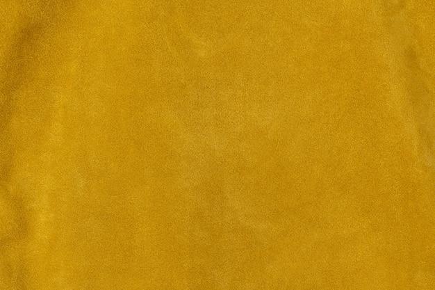 Saffraan goudgeel getextureerde suède leer oppervlak achtergrond