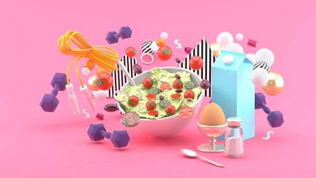 Salades, melk, eieren, halter, oefentouwen temidden van kleurrijke ballen op roze. 3d-weergave.