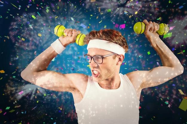 Samengestelde afbeelding van geeky hipster poseren in sportkleding met halters