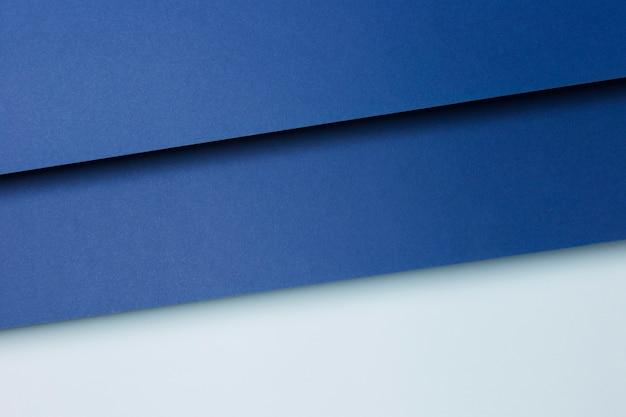 Samenstelling van blauwe vellen papier achtergrond
