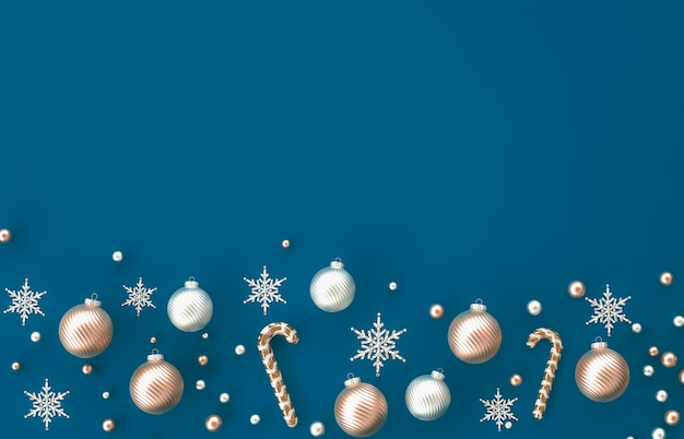 Samenstelling van de kerstmis 3d decoratie met suikergoedriet, kerstmisbal, sneeuwvlok op blauwe achtergrond. kerstmis, winter, nieuwjaar. plat lag, bovenaanzicht, copyspace.