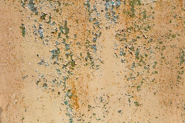 Samenvatting aangetaste kleurrijke roestige metalen achtergrond