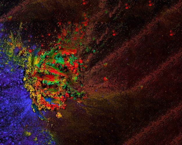 Samenvatting gekleurde stofexplosie op zwarte achtergrond