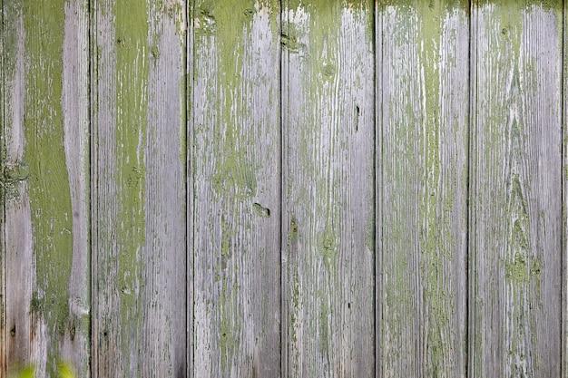 Samenvatting met houten textuur en peeling afgeveegde groene verf.